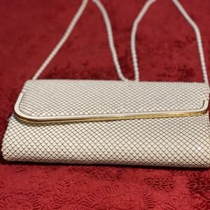 White purse with long white chain